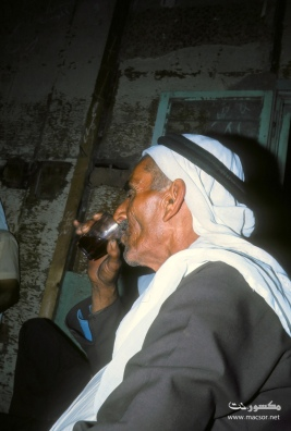 17 Abu-'Abūd rests with a cup of chai