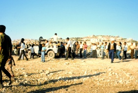 34 The formal greeting line arrives behind the hadaya jeep
